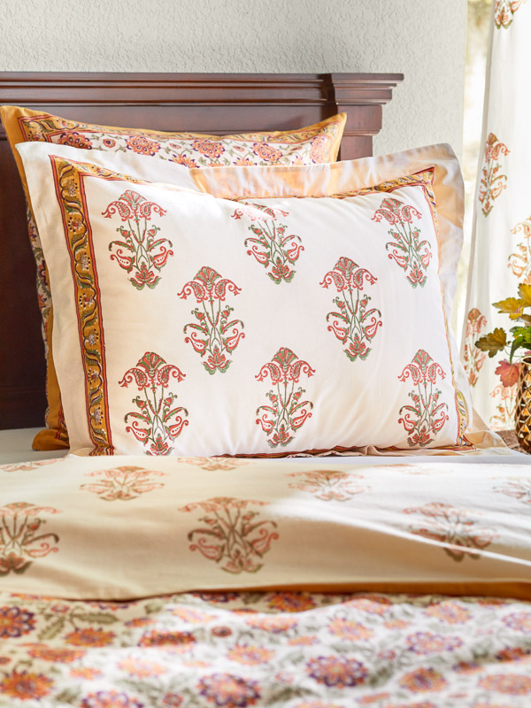 elegant Indian woodblock print pillow and orange bedding