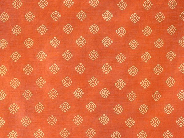 Orange fabric swatch with gold orbs as on a sari