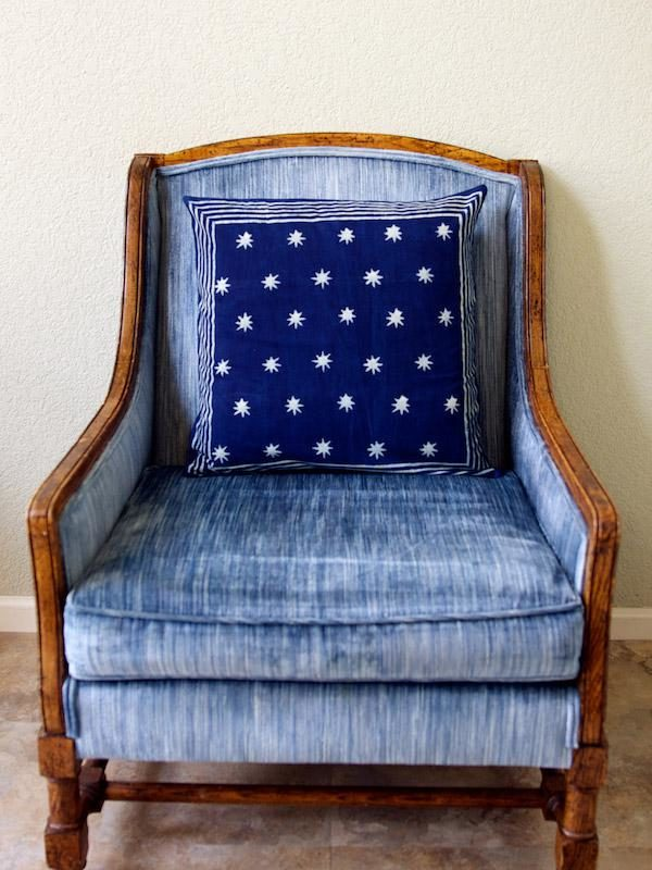 Decorating with blue home decor with a blue pillow on a blue chair