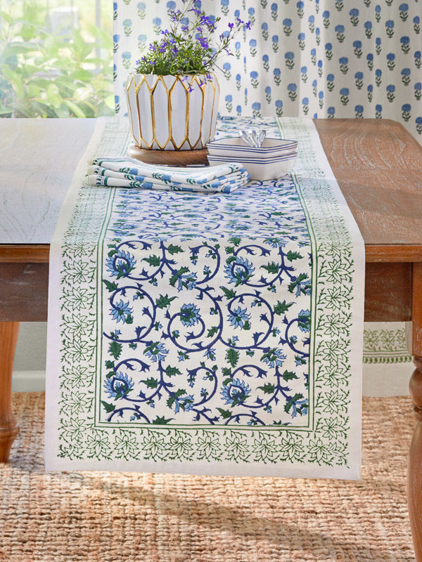 green, blue and white table runner with botanical print