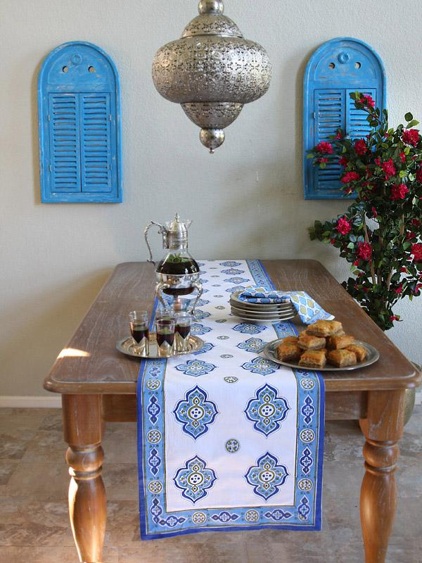 white and blue table runner in a Moroccan pattern