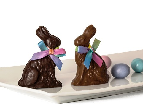 Chocolate bunny place setters for Easter tablescapes, each are wearing a multi-colored bow tie
