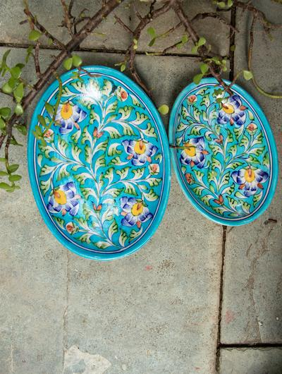 blue pottery serving dishes from India to go with Indian curtains