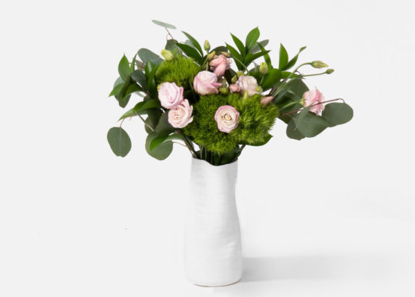 Pink flowers in a white vase and lots of greens for an elegant English Gardens floral bouquet