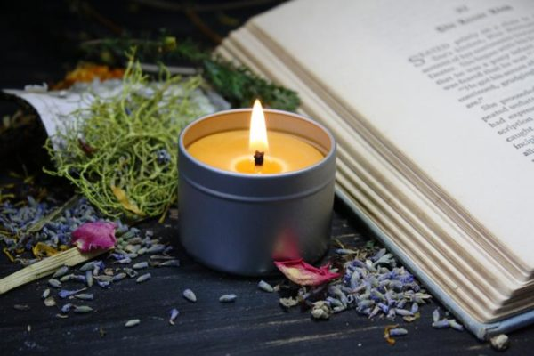 lavender serenity candle next to a book