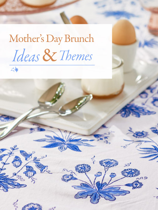 blue and white floral tablecloth, egg cups, spoons, and a sign that says Mother's Day Brunch Ideas & Themes
