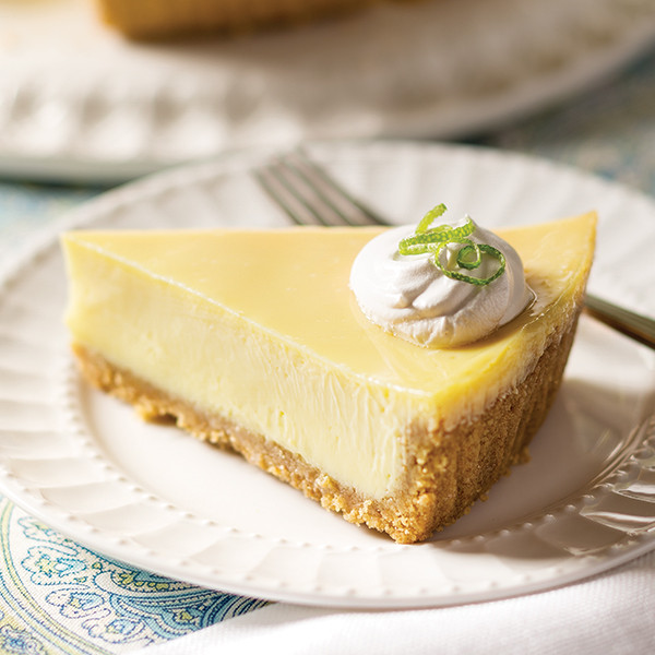 key lime pie with whipped cream dollop and lime zest on a plate at tropical Mother's Day brunch themes