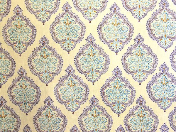A fabric swatch with blue and yellow French country pattern