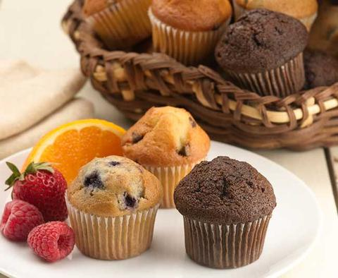 assorted muffins and fruit for  breakfast in bed on Mother's Day