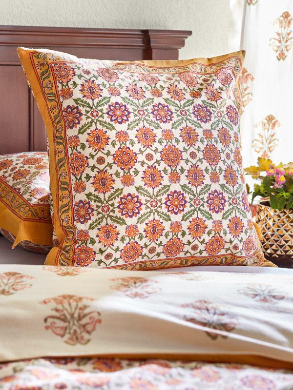 orange flower pattern pillowcase on bed, Persian print, block print pillow