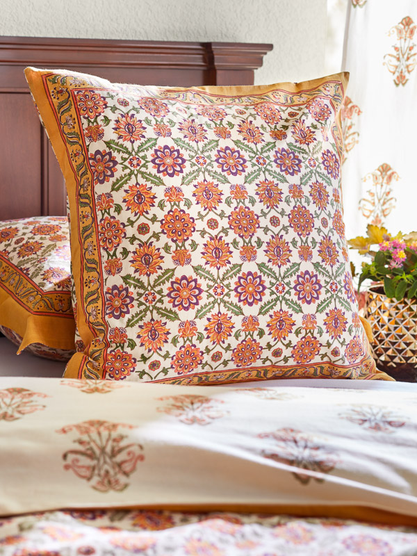 Orange floral pattern pillow cover in a Euro sham