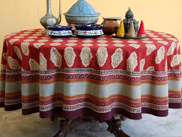 red moroccan round tablecloth with serveware