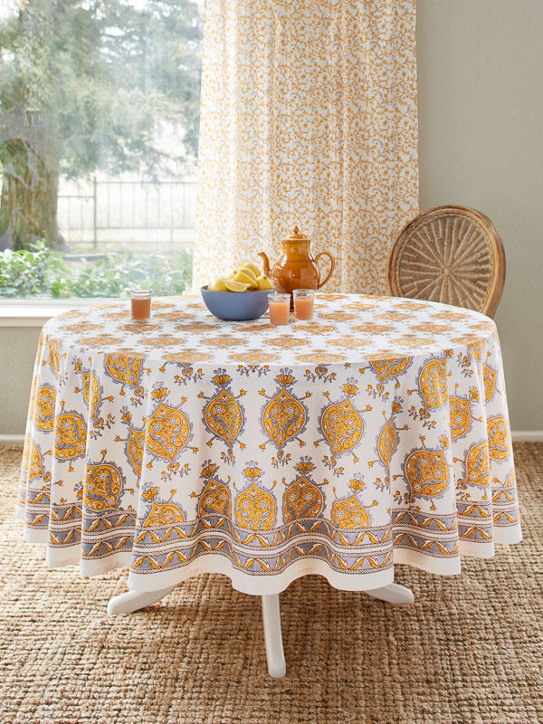 white and yellow round tablecloth in breakfast nook