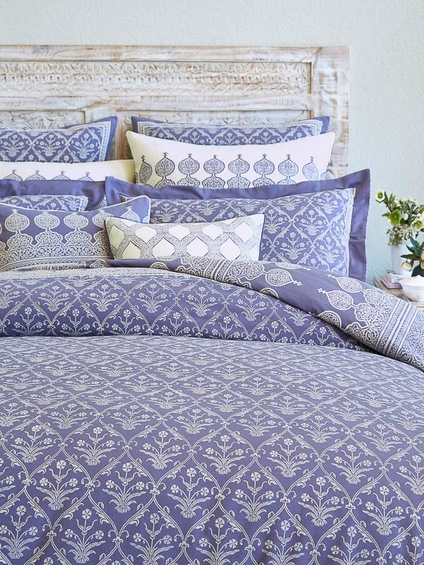 how to make a bed with purple bedding and pillows