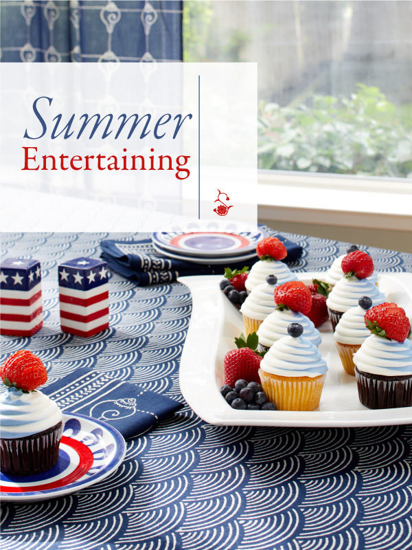 Red, white, and blue cupcakes are presented on one of our blue summer tablecloths
