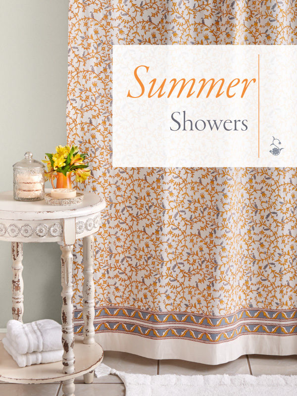 Grey, yellow and white shower curtain hangs in a summer style French country bathroom.