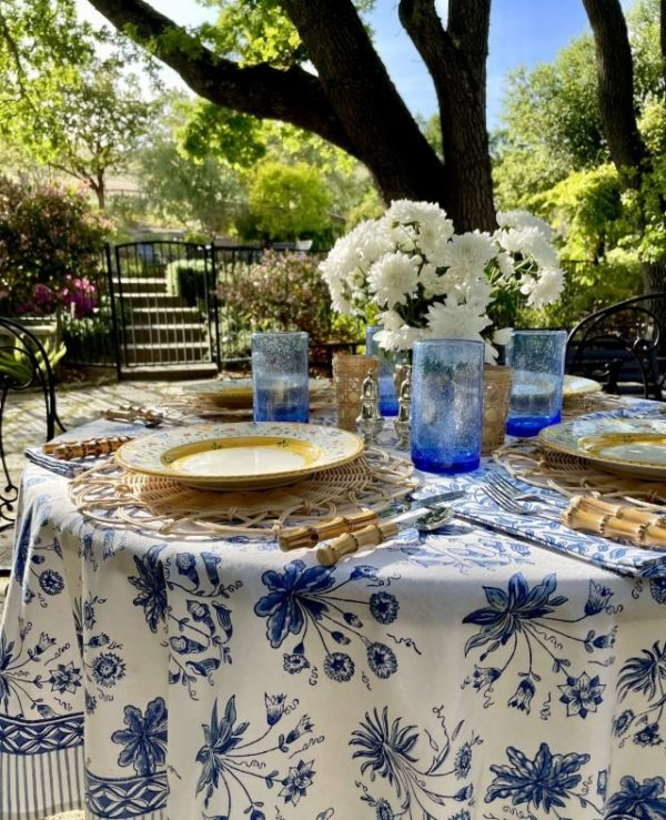 floral pattern blue and white tablecloth at an outdoor table setting