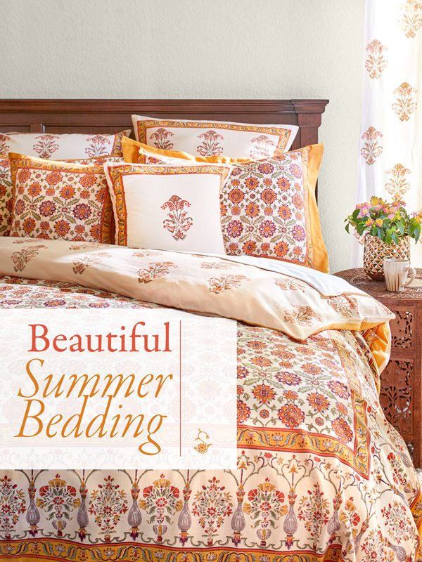 orange floral bedding with sign that says beautiful summer bedding