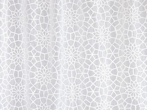 Block printed white sheer curtains with a Moroccan pattern