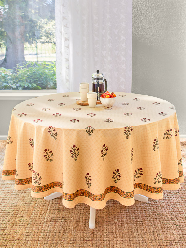 Pale orange tablecloth with red poppy print to go with orange home decor
