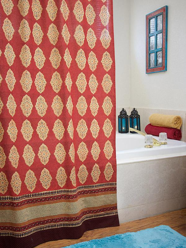 A red fabric shower curtain with a moroccan design creates a bohemian bathroom.