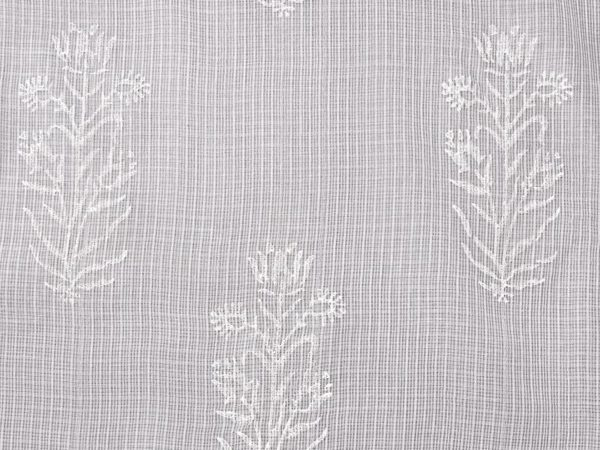 White kota doria fabric with a tulip pattern creates beautiful white sheer curtains.
