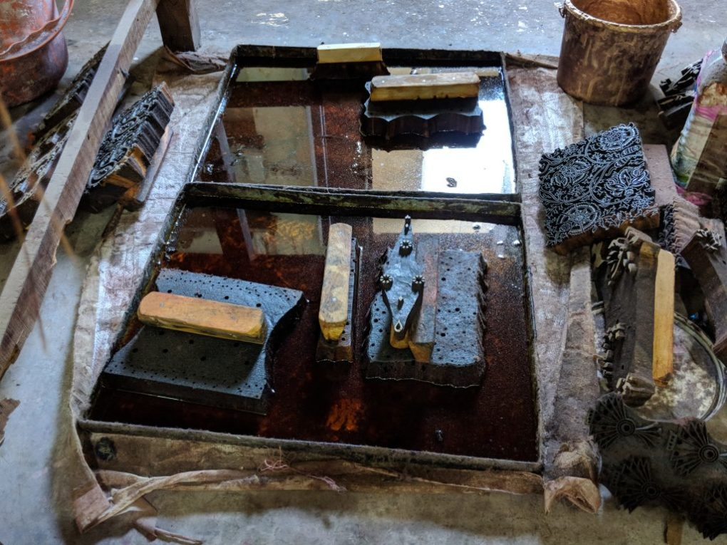 wood blocks used for block printing stand in trays of mustard oil to prevent warping