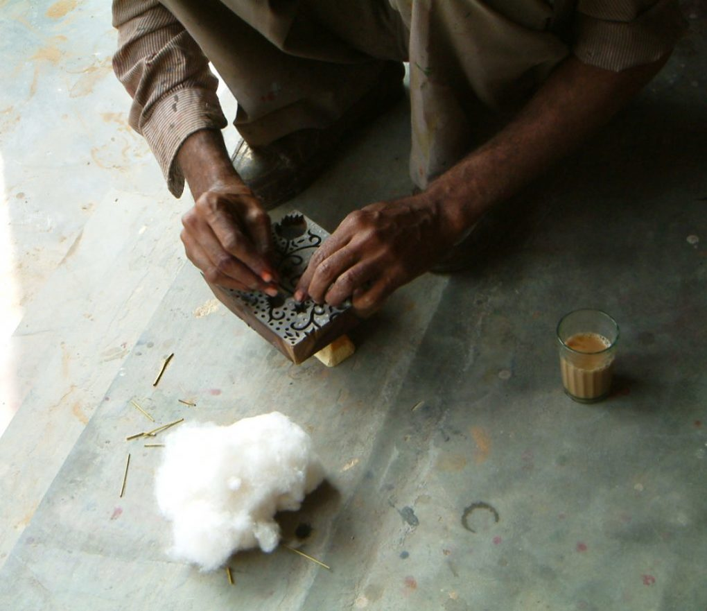 Artisans filled wood blocks with cotton for even application