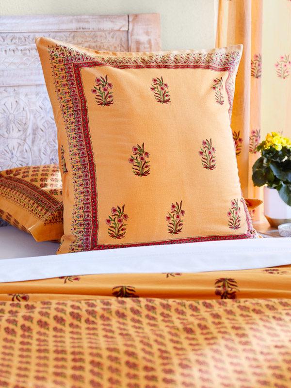 orange throw pillows with floral print
