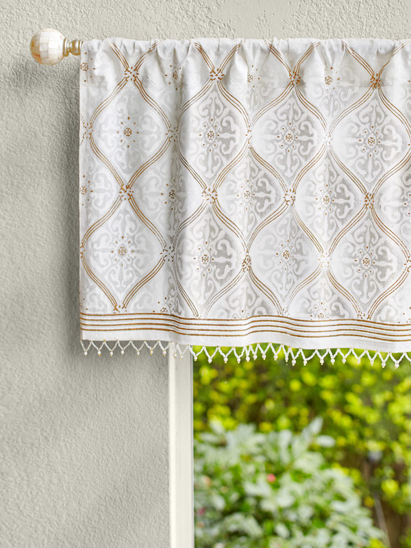 white and gold beaded valance