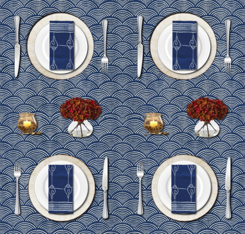 A rustic Thanksgiving table setting with blue Thanksgiving tablecloths