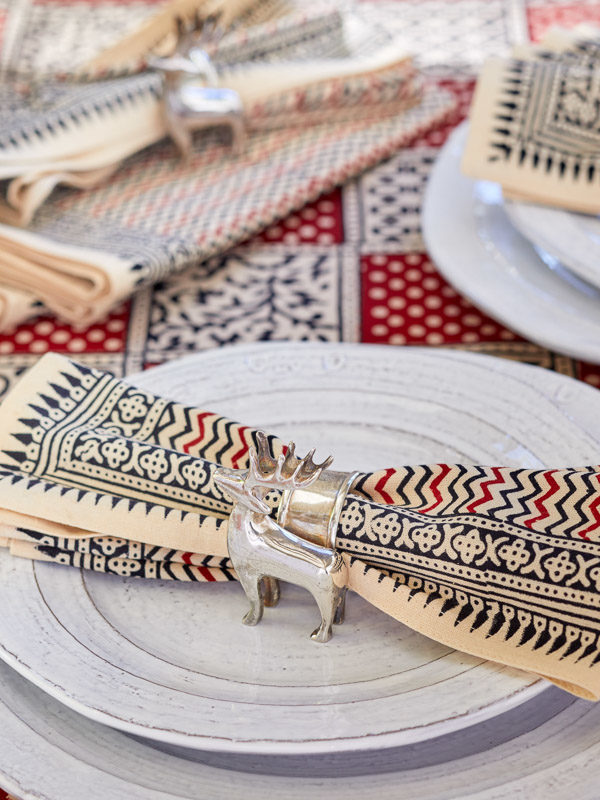 black and red tablecloth, red Christmas tablecloth with reindeer shaped napkin rings