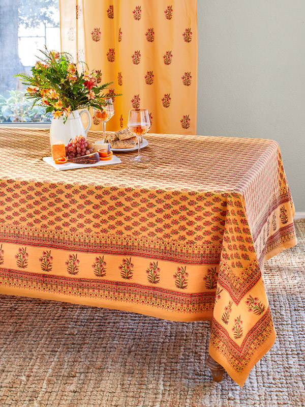 Thanksgiving table setting with an orange thanksgiving tablecloth