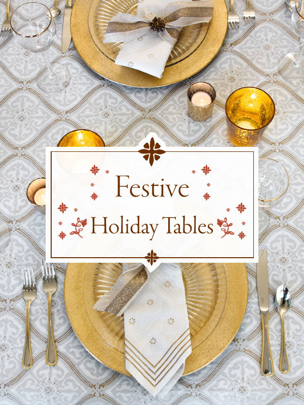 gold and white Christmas tablecloth and table setting