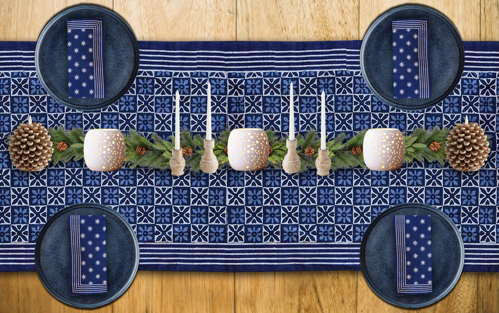 A blue Christmas table runner and winter solstice decorations for your winter solstice celebration