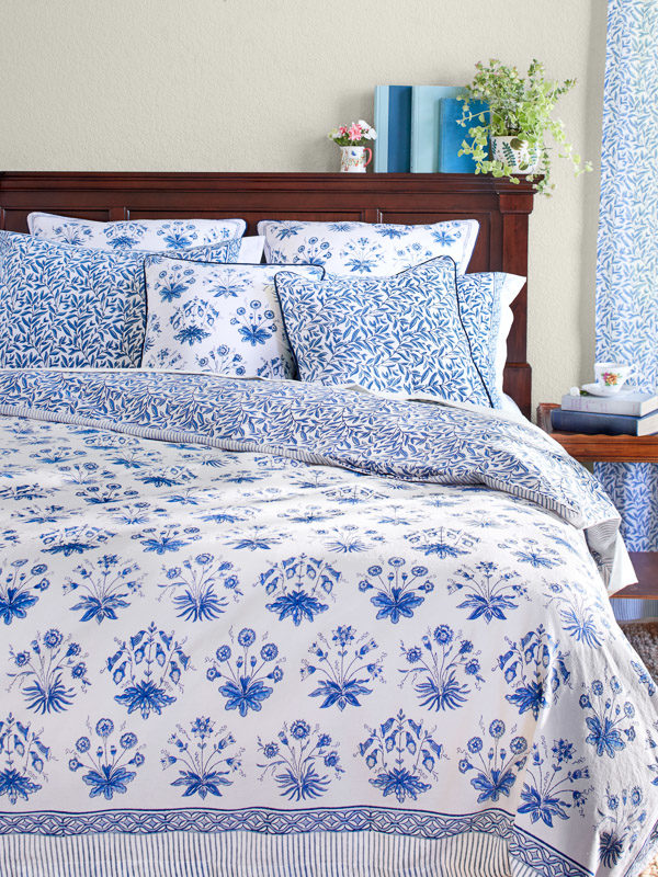 blue and white bedding with flower pattern