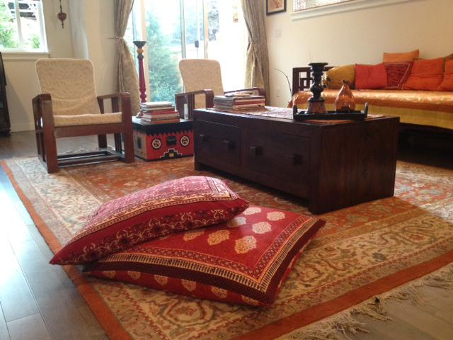red Moroccan pillows in a Moroccan style boho living room