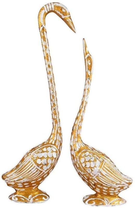 a pair of gold and jeweled kissing swans for boho table decor