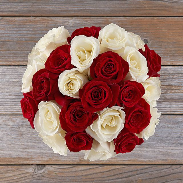 a bouquet of red and white roses for valentine's day