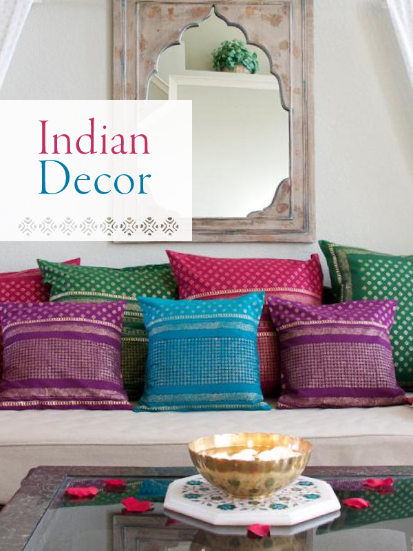 indian decor that consists of a collection of gilded sari block print pillows and limewashed indian mirror