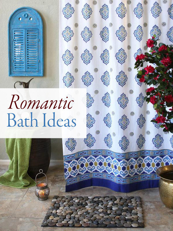 A Moroccan pattern fabric shower curtain, lanterns, and roses form a romantic bath setting