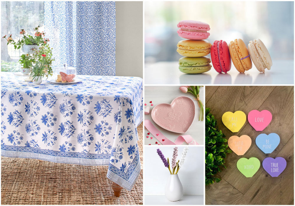 a white and blue Valentine tablelcloth with heart shaped candies, plates, colorful cookies, and velvet flowers