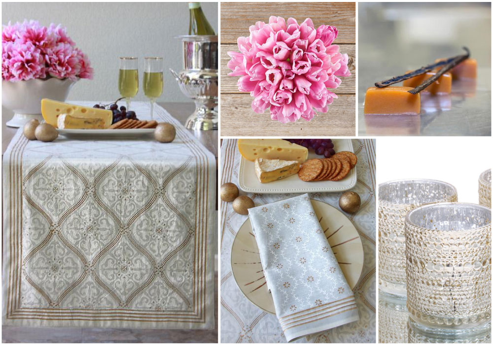 A white and gold Valentine tablecloth styled with mercury glass candle holders, pink tulips, and caramels