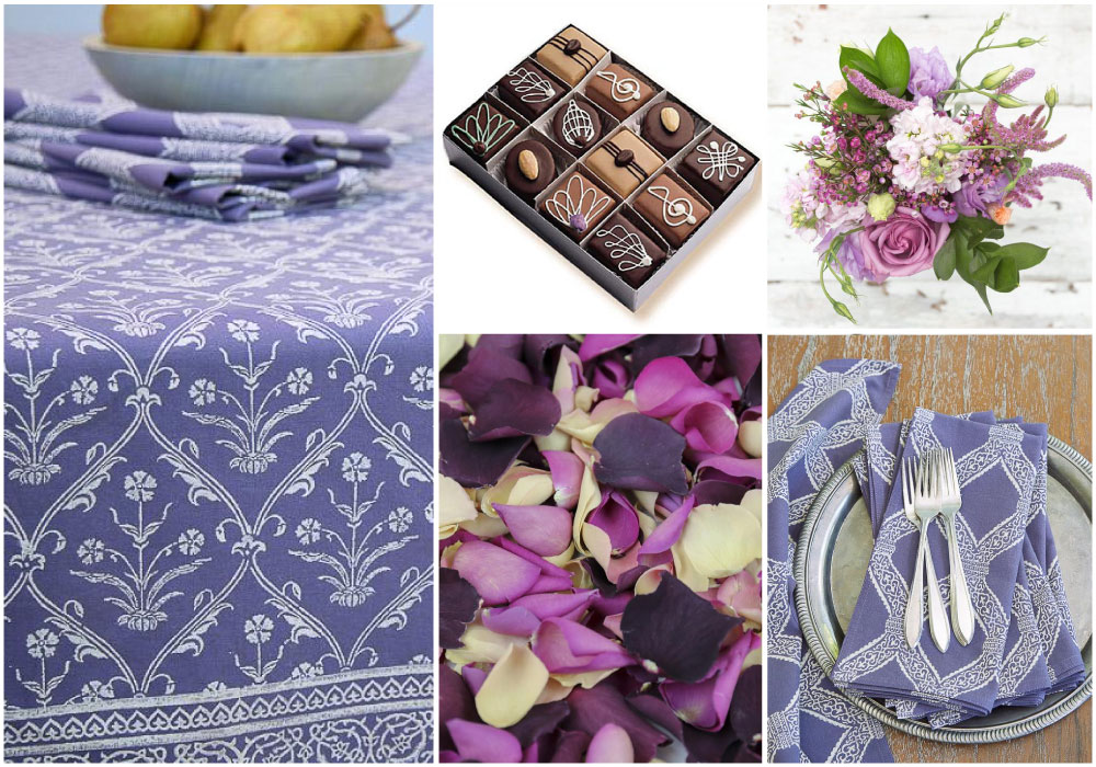 An elegant table setting with flower petals, chocolates, and cloth napkins for Valentine's Day celebrations