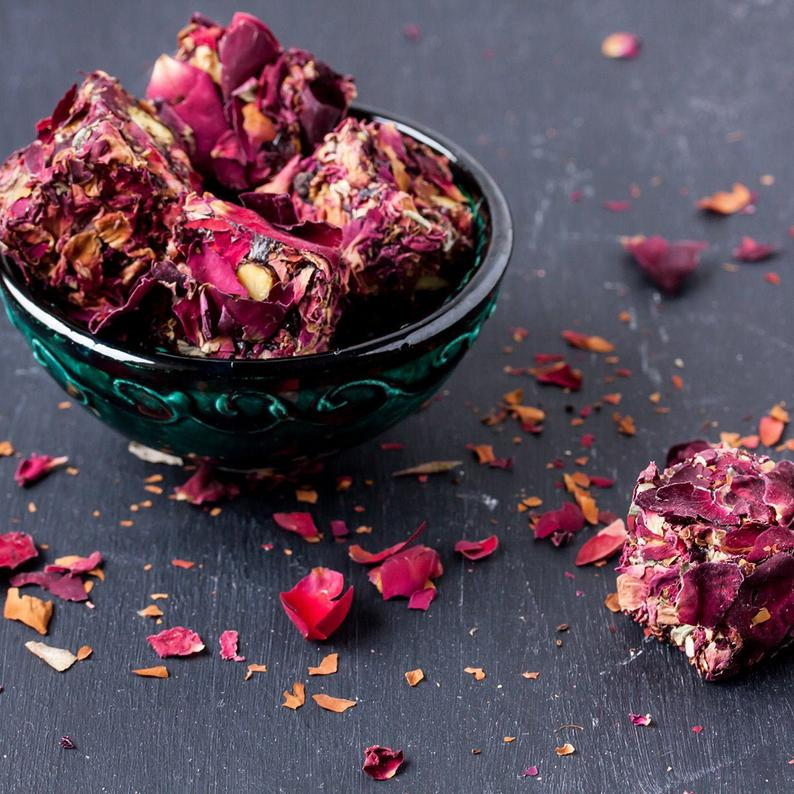 rose petal infused Turkish delight candy in a green glass bowl