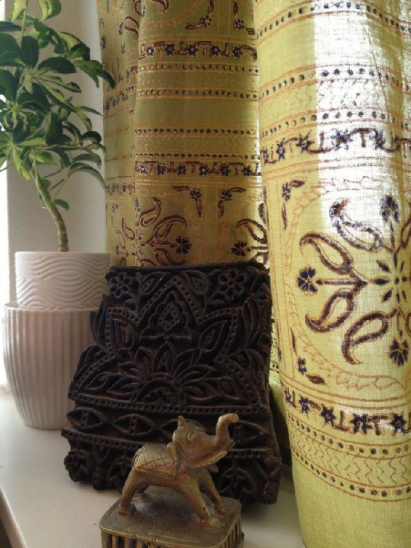 Indian wood block and green Indian curtains