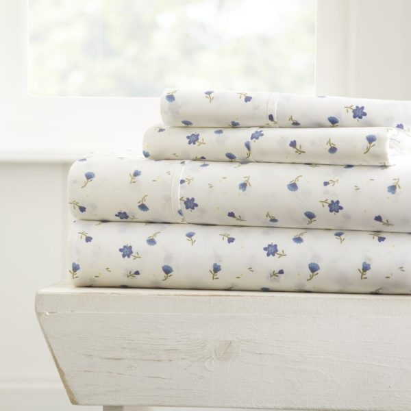 floral bedding--white sheets with gentle blue floral pattern like Texas bluebells