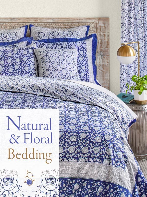 Blue floral bedding with a white and blue lotus flower pattern