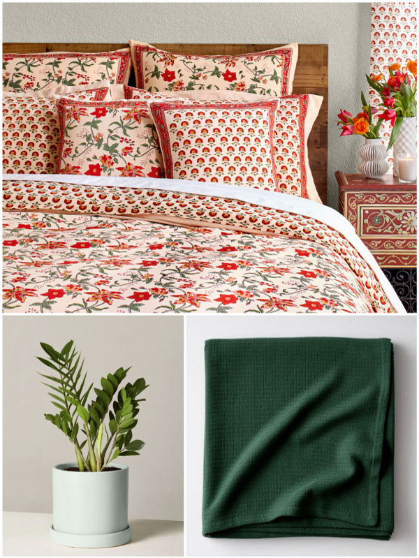 a tropical bedroom with tropical floral bedding, a red floral pattern duvet cover, a green plant, and a dark green blanket