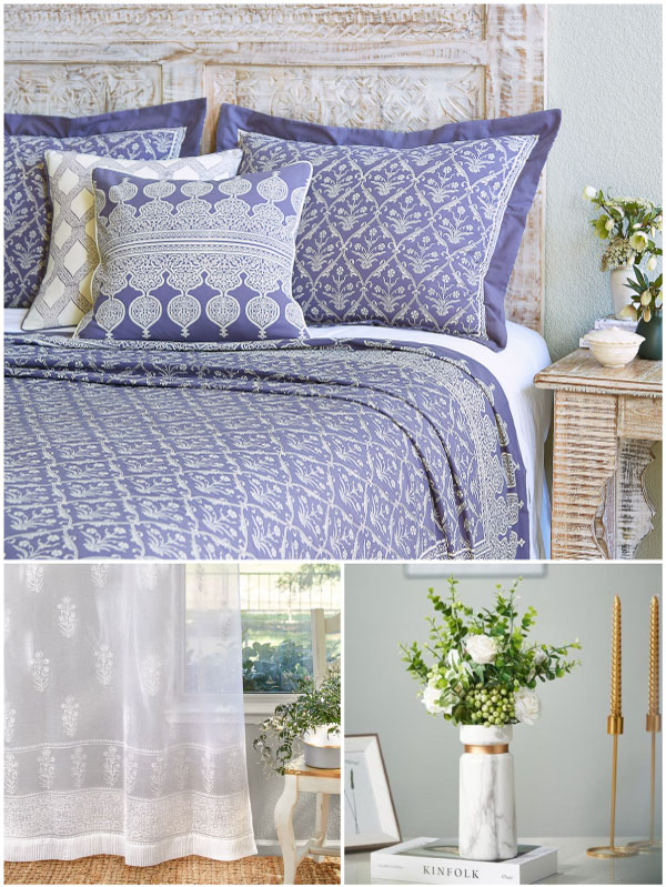 pretty floral bedding with a lilac purple floral pattern, a sheer white floral print curtain, and white marble vase filled with flowers